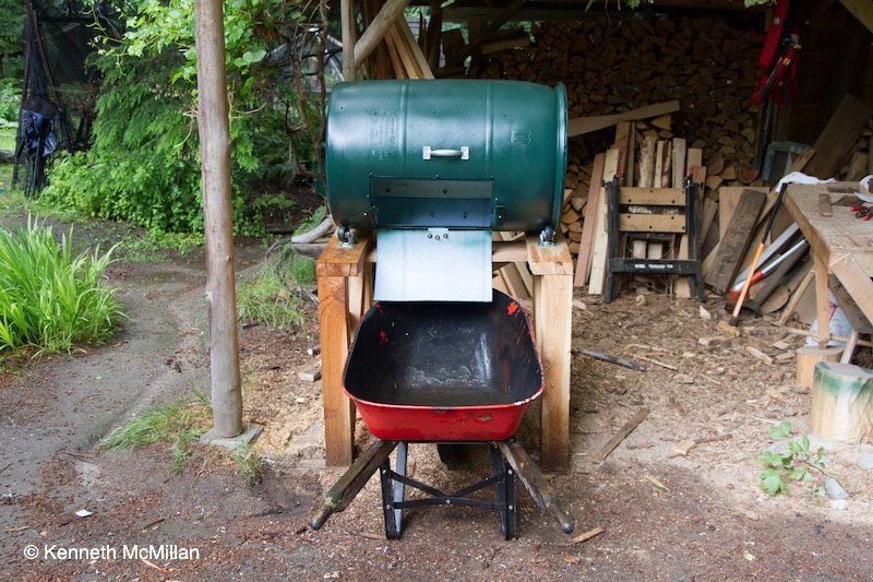 The wheelbarrow fits underneath to allow convenient emptying